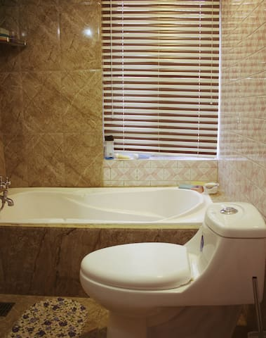 We provide very clean toilet - bathroom. 24 hr hot water. The guest are requested to save unnecessary waste of water.