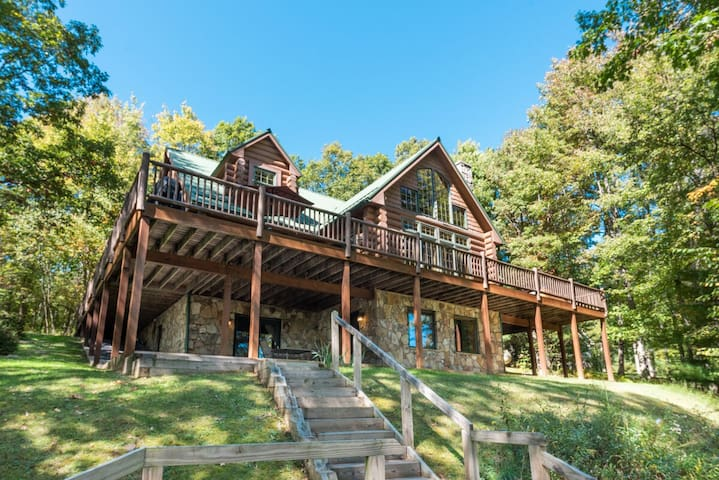 Lakefront home with dock slip, hot tub, fire pit, & game tables!