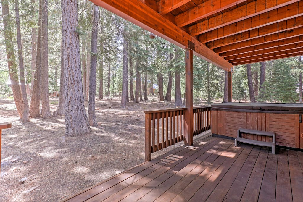 Sink into the private hot tub and look out to wooded views!