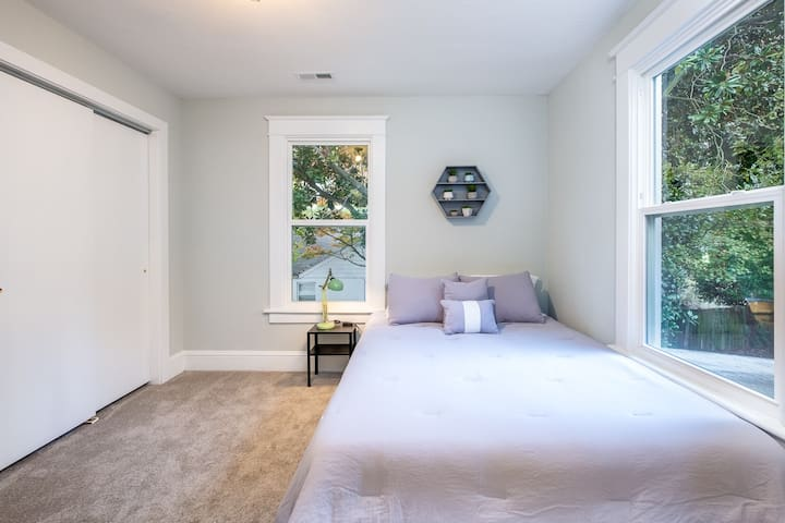 Bedroom 1 with a queen bed, Sealy memory foam mattress, luxuriously soft bedding.