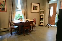 Dining area near the kitchenette with antique, tin-top table for four.