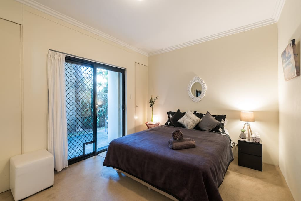 Spacious bedroom with super comfortable bed with a leafy outlook and private garden.