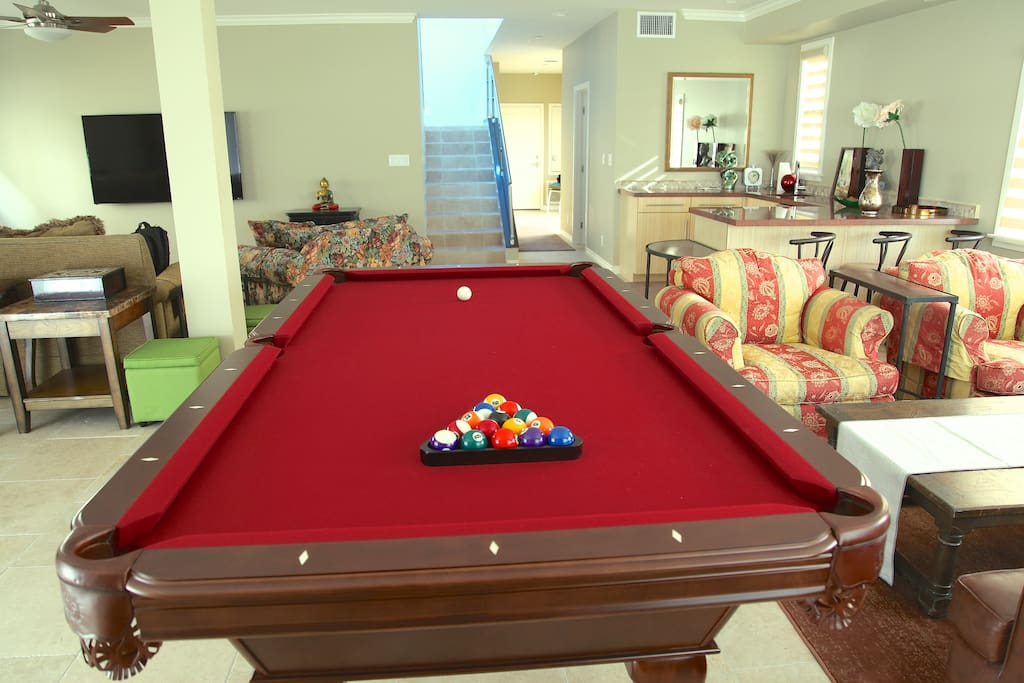 "Xtra lagre game room with pool table, bar, 70"" flat screen TV, sound system 4 your playlist on the iphone."