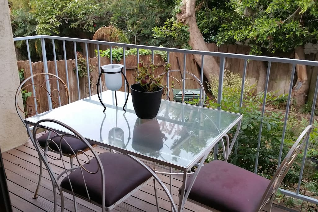 Private balcony overlooking the back yard.