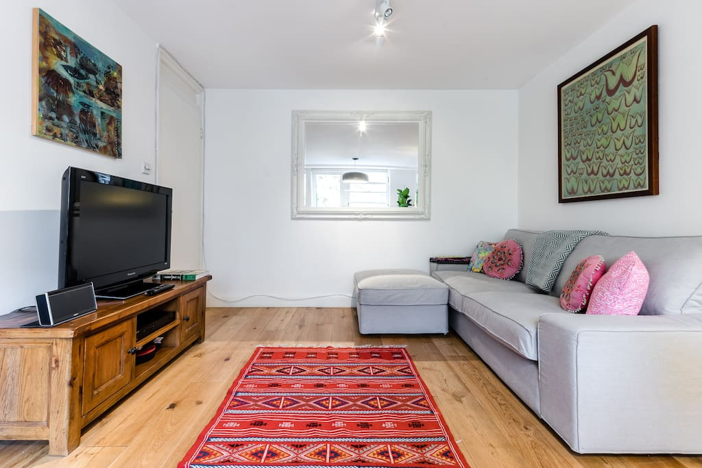 Comfy furniture and colourful accents throughout