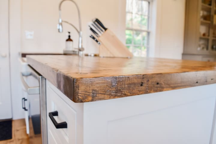 Reclaimed kitchen peninsula - we used salvaged wood from original kitchen ceiling joists.