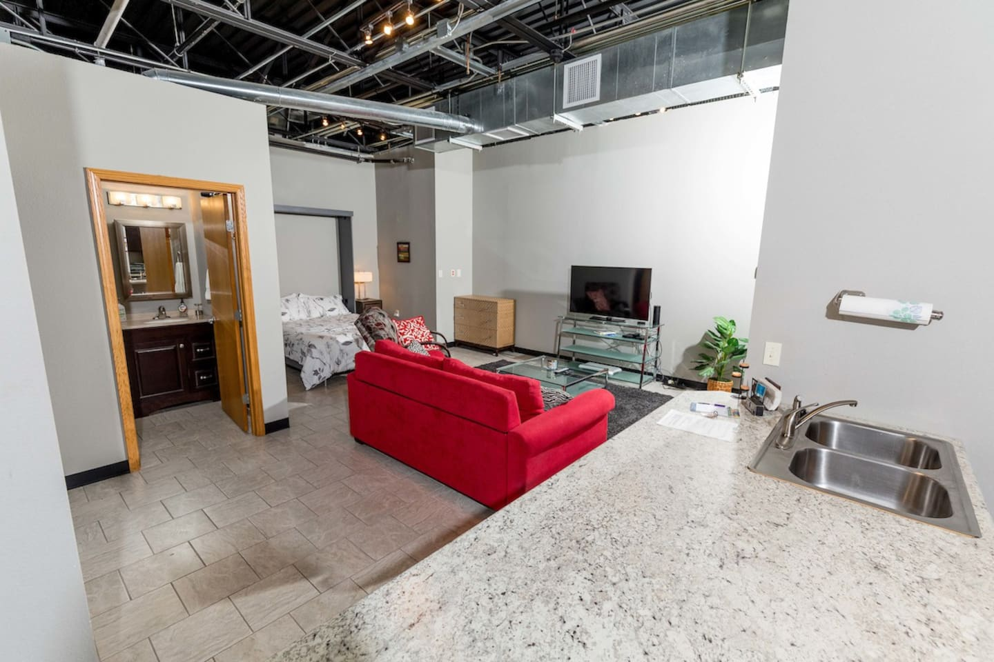 Studio apartment sleeps up to 4 in an industrial style office building.