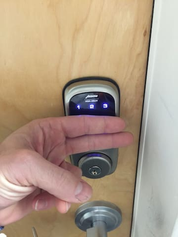 The apartment door is secured by a digital door lock. Access code is changed for every guest. To turn on the key pad place the back of two fingers on the pad until key pad lights up. Enter your custom code. (Custom code will be provided to you in the check in details a day before you arrive.)   Placing two fingers on the digital pad also locks the door.