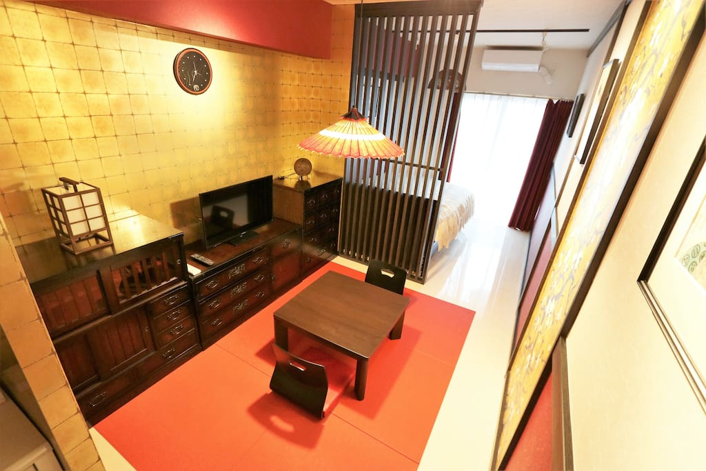 The room has traditional yet minimalist dining area which also serves as the living room where the flat screen TV is located.