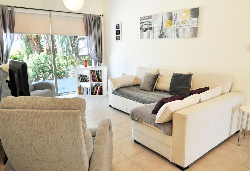 Living Area with TV (DVD Player & Chrome Cast, Wifi, Two Reclining Chairs, L-Shaped Sofa, Books & DVDs
