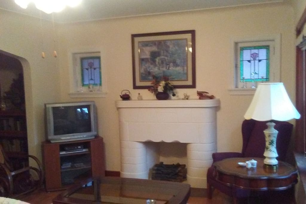 Living room with decorative fire place