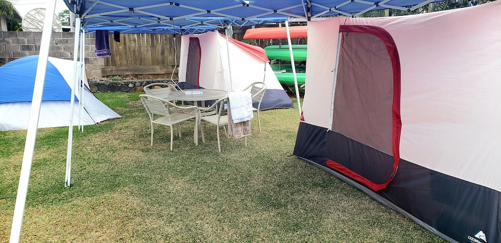 Nice little phone charging and common area under tent