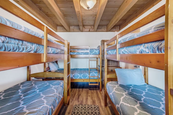 3 bunk beds (6 beds total) make this the perfect room for the kids