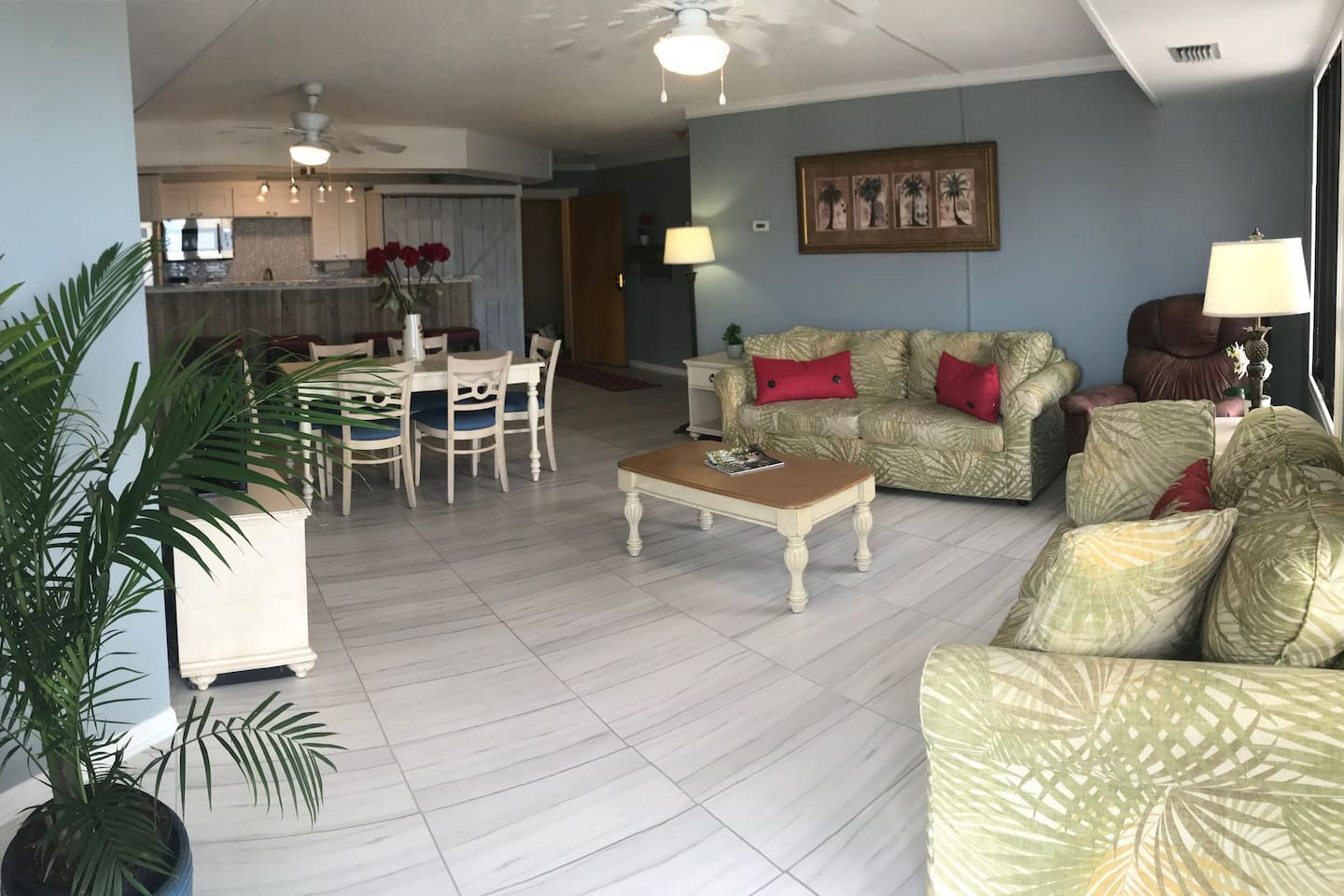 Living Room, Dining Area and Kitchen. LR equipped with Queen Sleeper Sofa, Loveseat and Arm Chair).