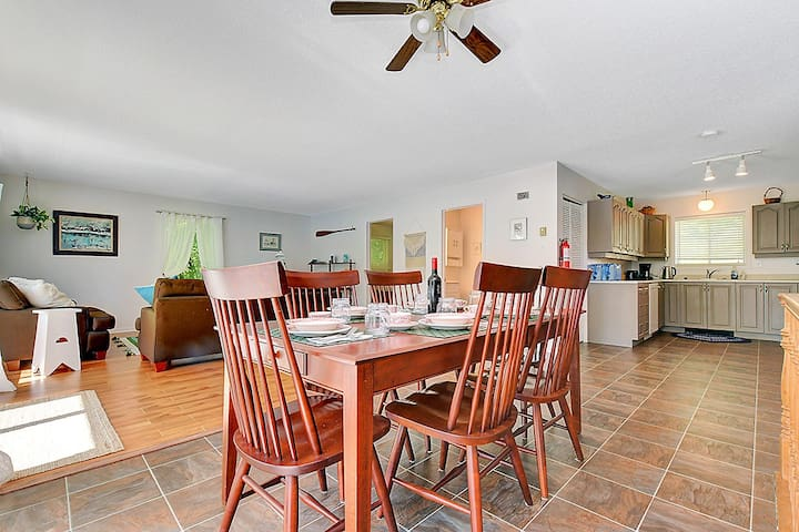 Dining and living room areas, open concept for a bright and airy feel and lovely view of the water.