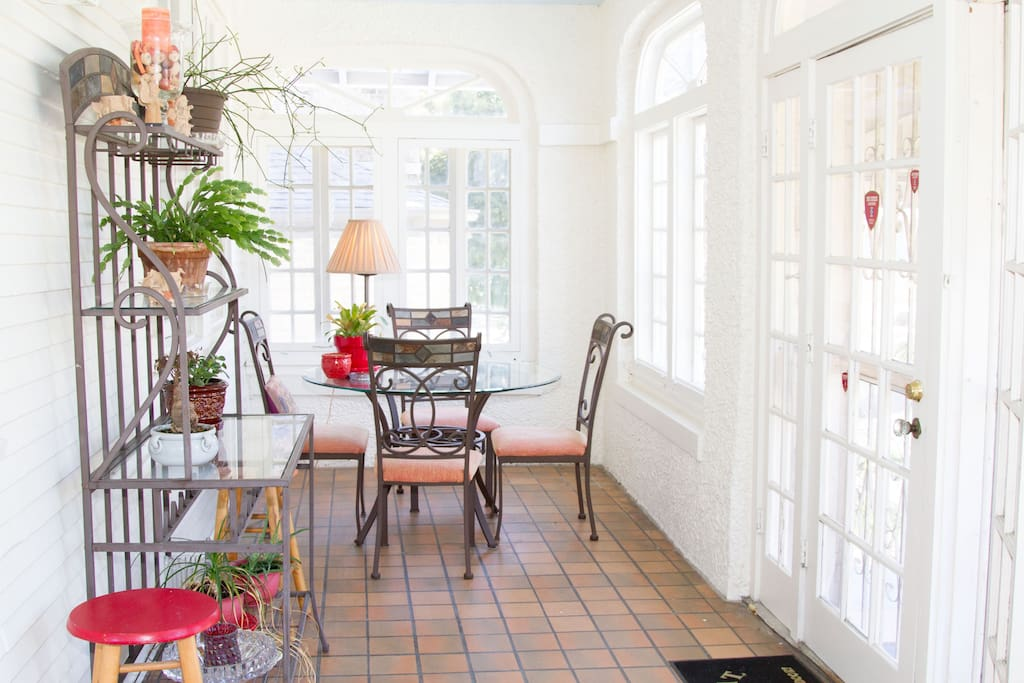 The fully enclosed porch/sunroom is great for coffee, relaxation and hanging out.