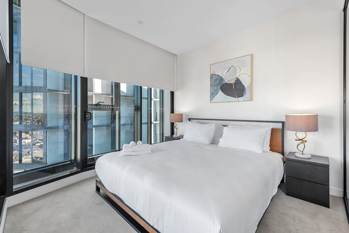 Air-conditioned bedroom with ultra-comfy king bed