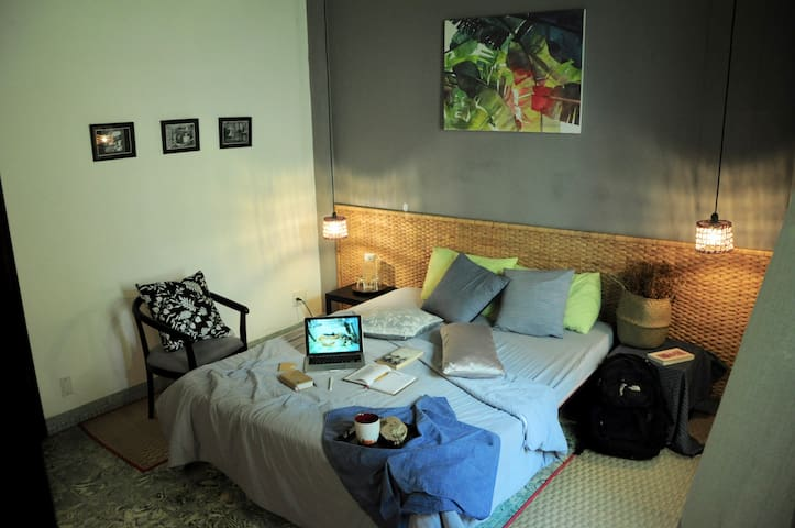 Stylish couple bedroom. The room is very new. It is in a lovely restored old house, so it has modern style while retaining the old charm of pre-war, modernist architecture.