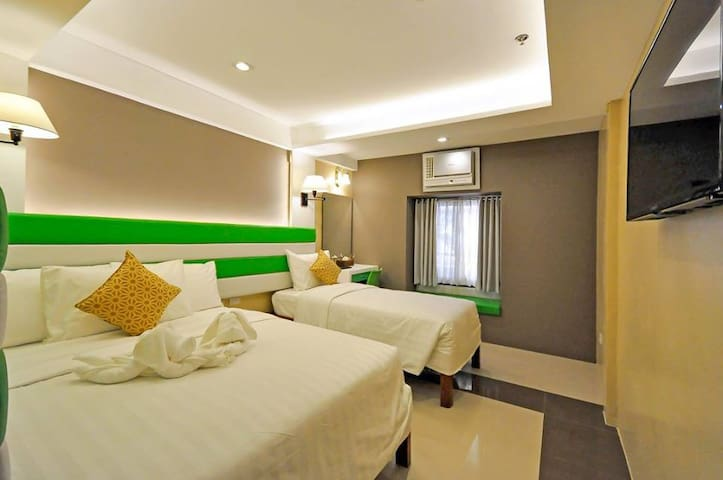 Elegant Super Deluxe Room at Red Coco Inn