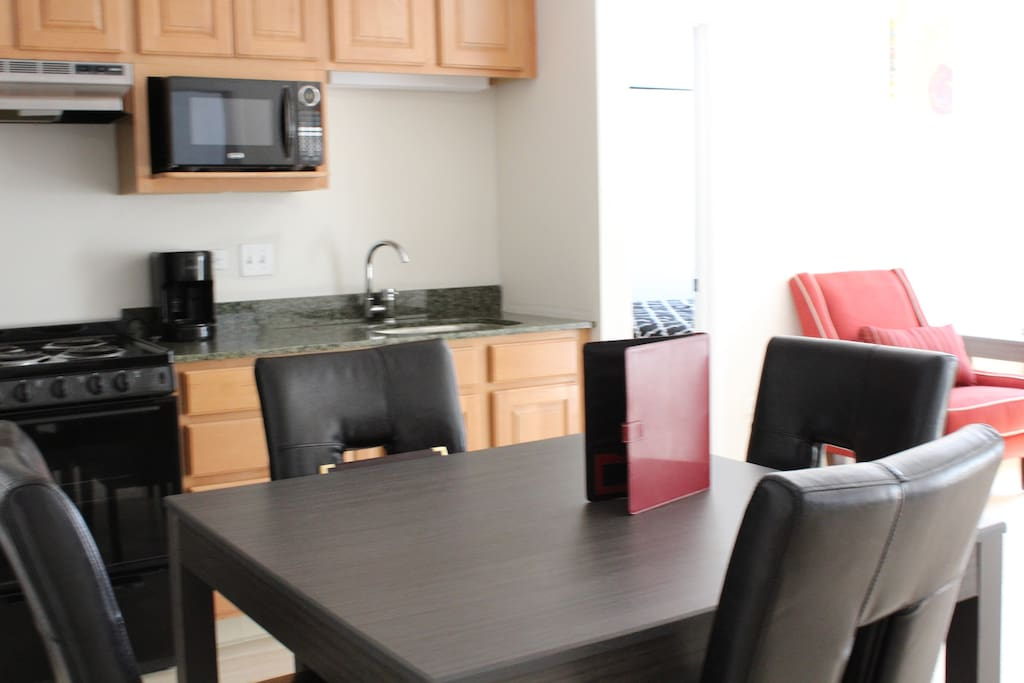 Dining seats four. Large kitchenette with all your basic utensils and supplies!