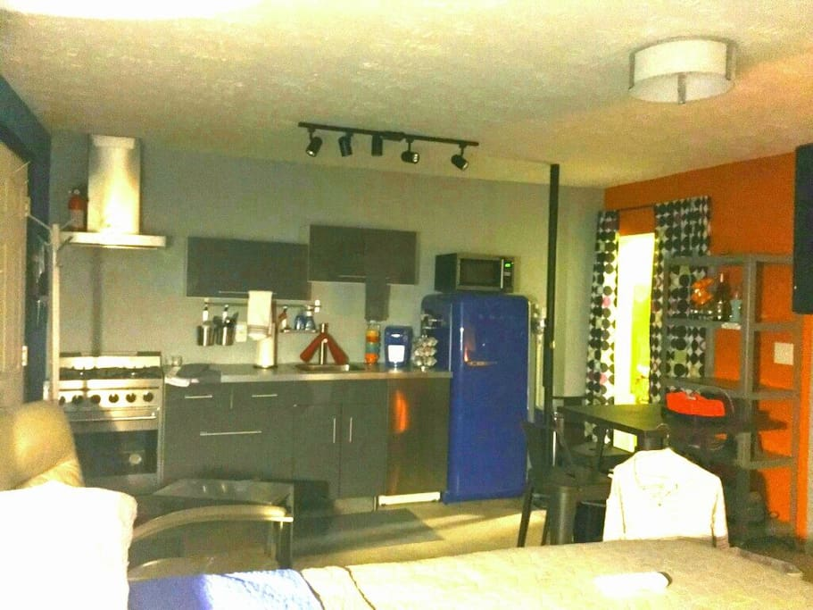 Studio has a fully equipped kitchen, leather recliner, good lighting, kitchen table...this picture shows perspective for size.