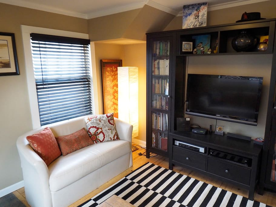 """Downstairs living area: 40"""" TV, DVD, CD. Books and CD library"""