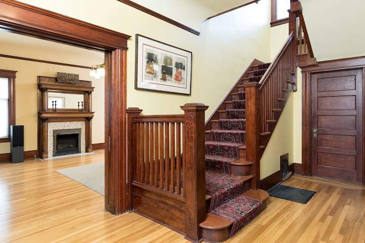 Straight ahead as you enter, you are greeted by classic steps leading to the bedrooms upstairs, with the living room on the left ...