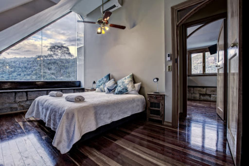 King Size Bed - view of the treetops and mountain during the day and the stars and moon at night.
