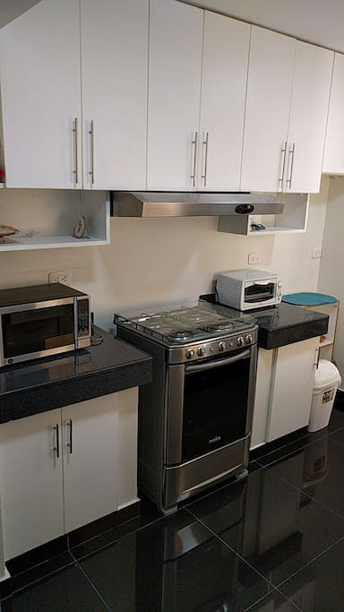 Kitchen with oven, microwave, shelf space