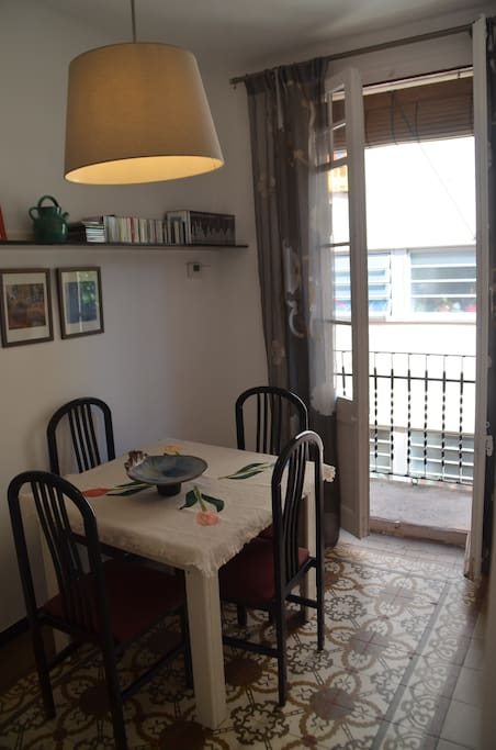 Dinning room with balcony and original tile