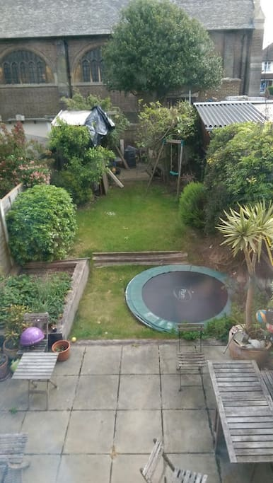 Large garden with trampoline