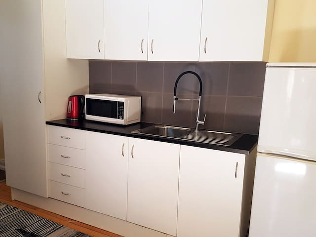 Kitchenette with tea & coffee provided.