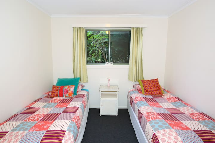 Second bedroom has two single beds, all linen included.