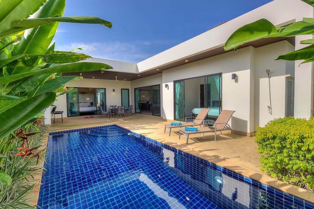 The villa is L-shaped around the pool