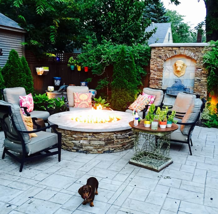 Private backyard with a beautiful water fountain and cozy fire pit!