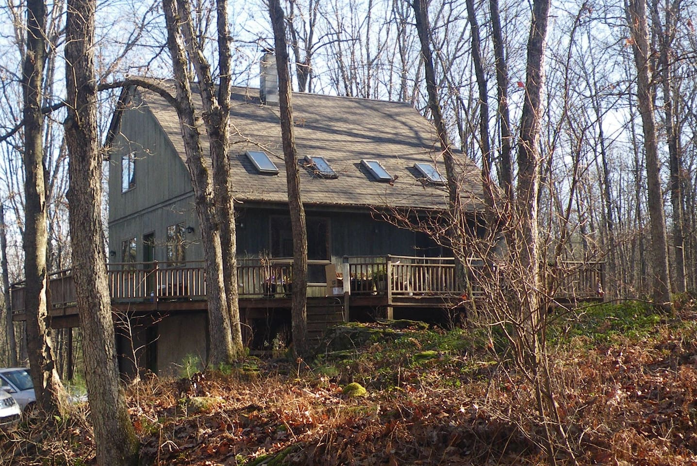 Enjoy peace and acres of woods and wildlife from the wraparound deck.