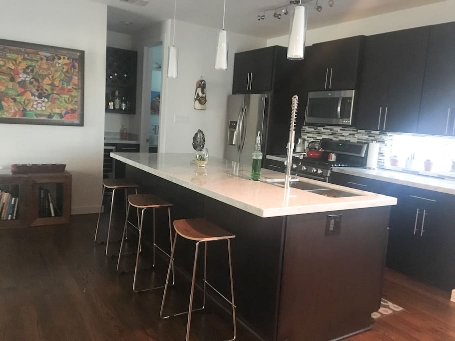 Open kitchen with bar stools at island