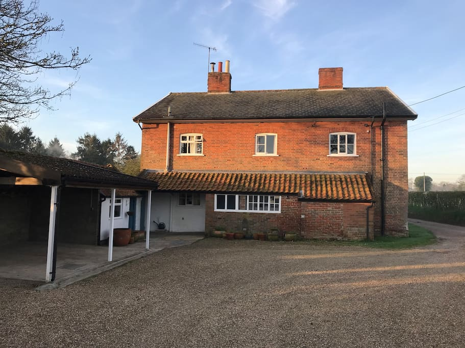 The house from the rear with ample, private parking including garages