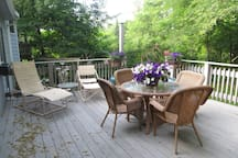Wonderful for entertaining in my very private back yard. This pretty deck is just off the gourmet kitchen.   The grill is just two steps down on a brick patio.