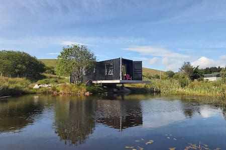NEW - SHIPPING CONTAINER Home on Coastal Lake -WOW