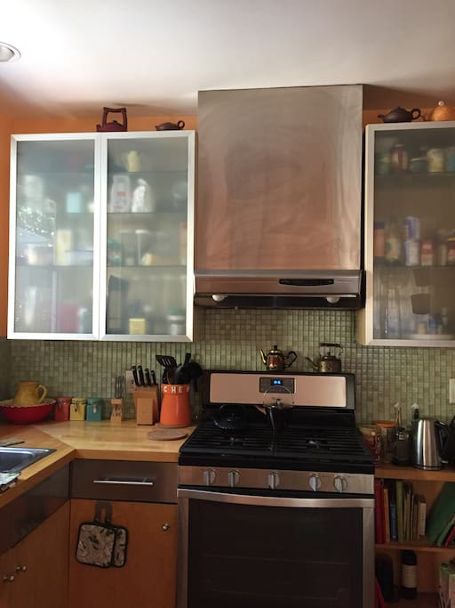 Updated kitchen with stainless steel appliances, french door fridge, glass tile.