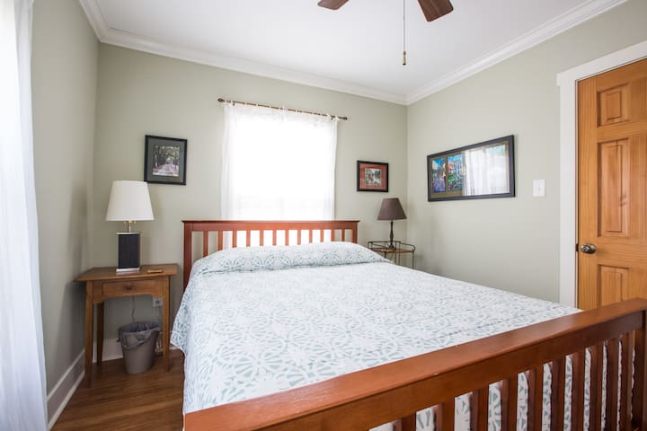 Front bedroom with queen size bed and closet