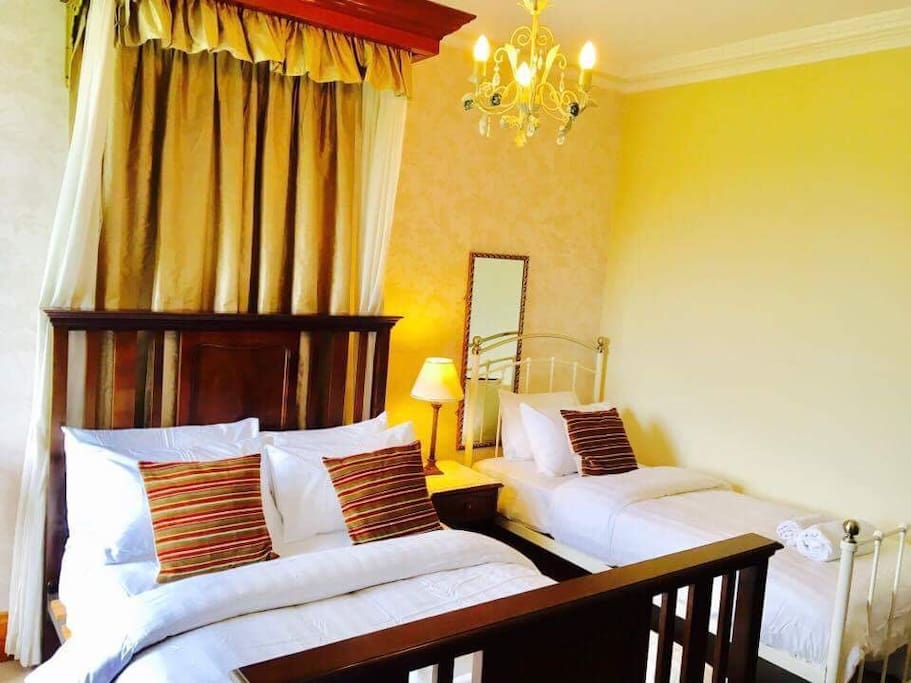 Double bed and single bed with white cotton rich bed linen with 100% white cotton towels bathrobes and flip flops free for guests to use