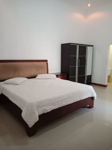 Master bedroom with bathroom and amenities