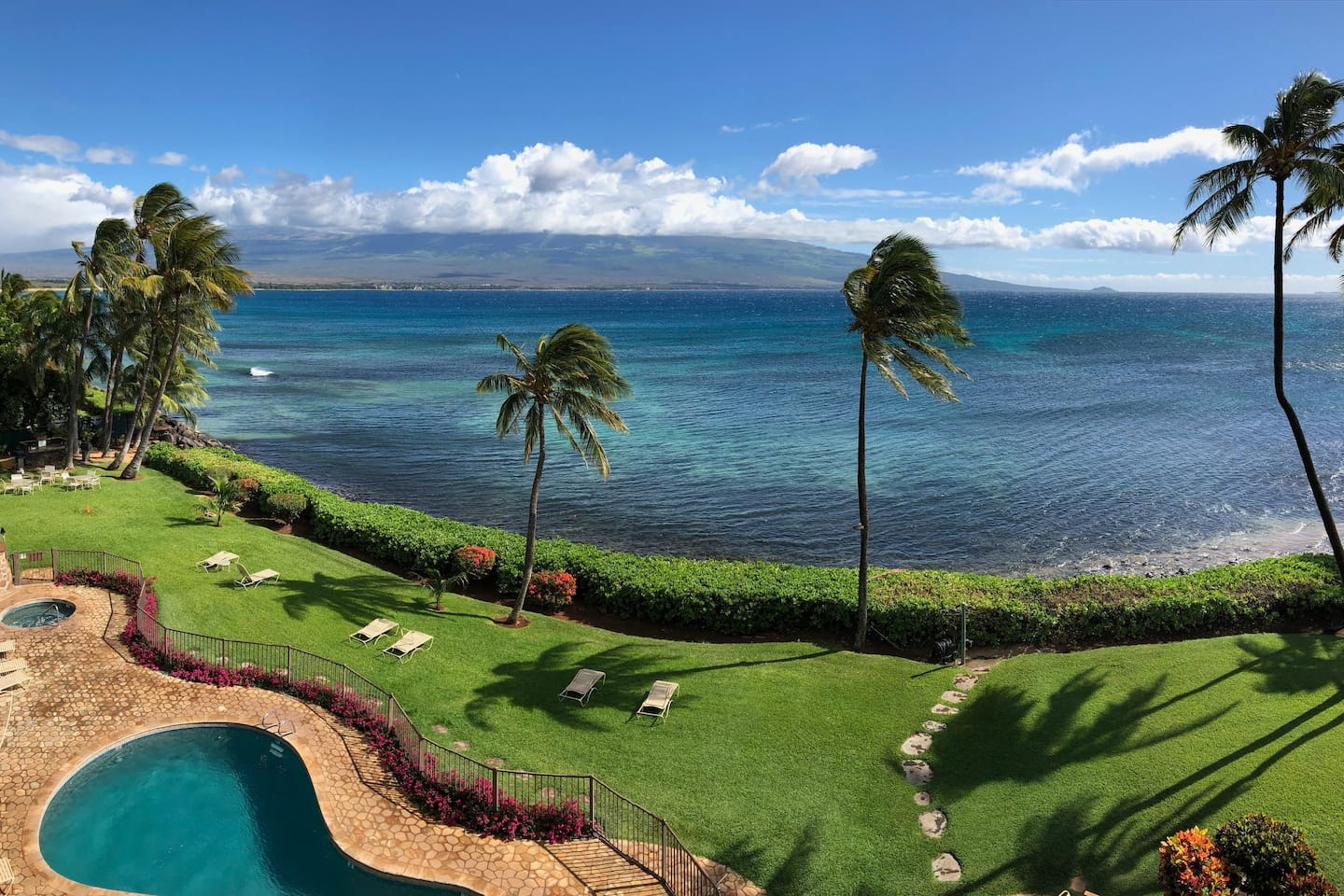 This is the actual view from your private lanai.  Note the reef just offshore, which is great for snorkeling!  Watch sea turtles feed along the shoreline at low tide and in the winter months you will see whales jump and play out in the bay.