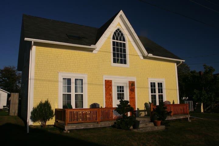 Yellow summer house near the ocean.