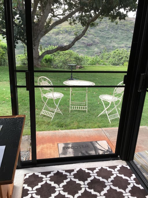 The table and chairs are located by the sliding door.