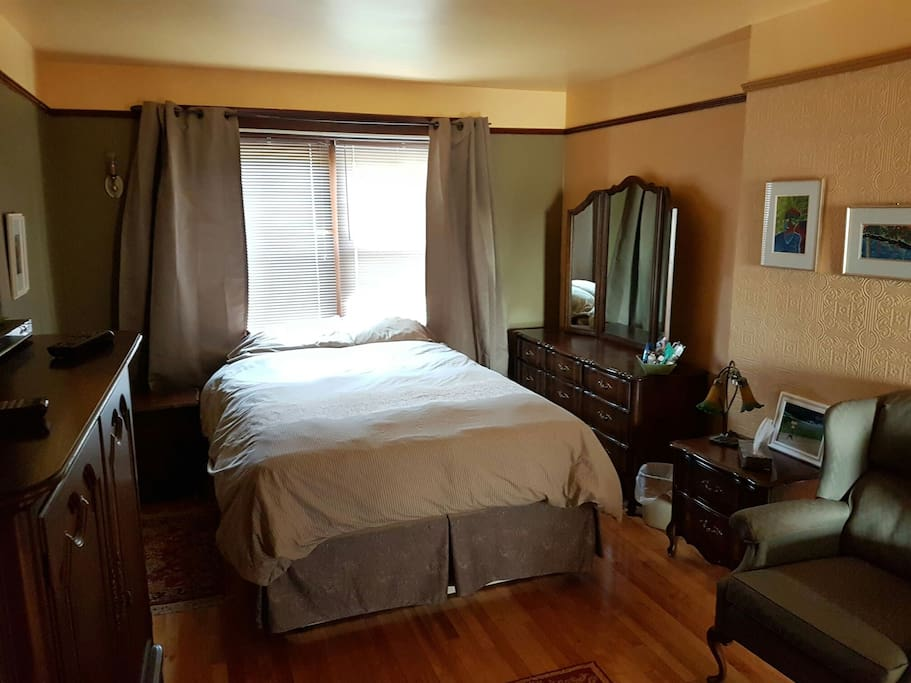 Master bedroom with sitting area and flat screen tv with attached bathroom