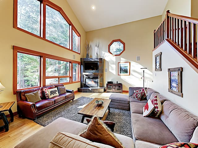 Designed with vaulted ceilings and picture windows, natural light floods the living area.