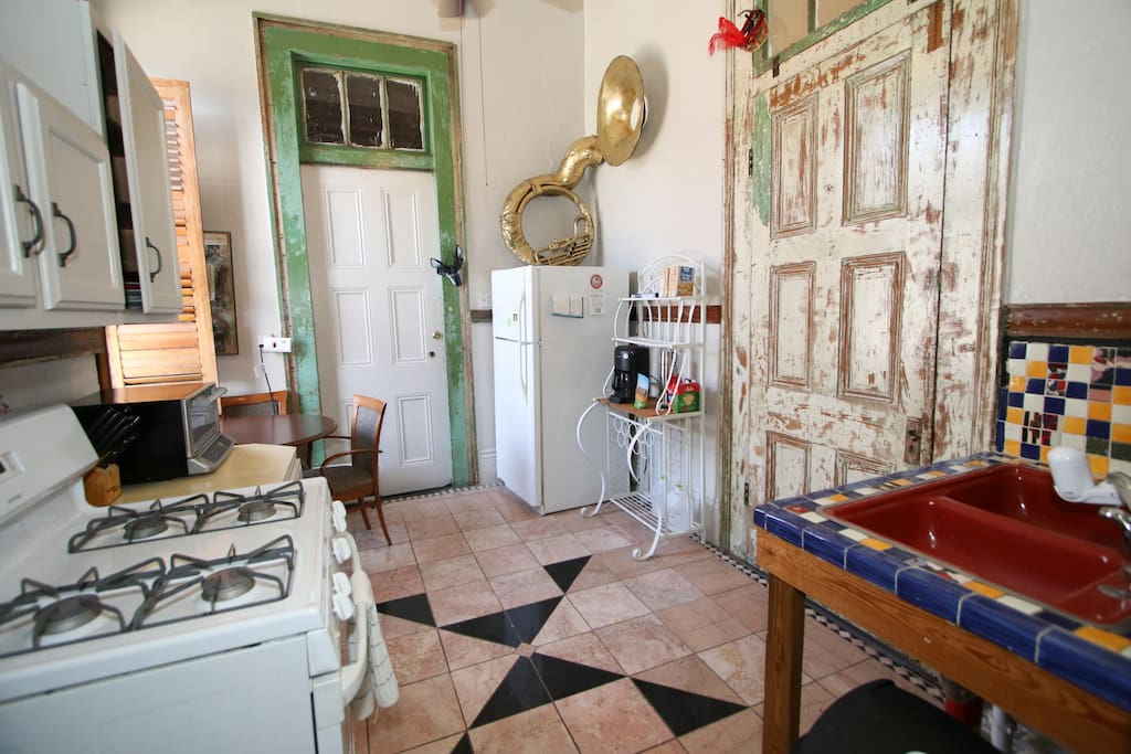 Full kitchen with refrigerator, stove, coffee maker and toaster oven provides you a respite from the wilds of the city and a place to relax.